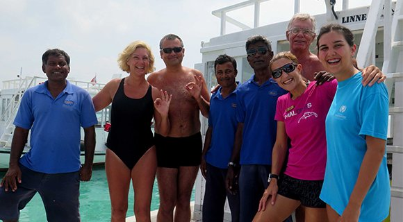 Family diving Kuredu Maldives