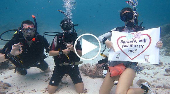 Romantic underwater diving proposal
